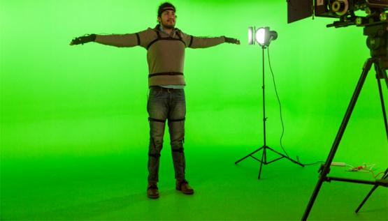 A student at Lesley University College of Art and Design models a motion capture system by Noitom.